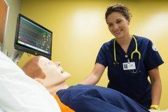 Kirtland Nursing students with adult male simulator